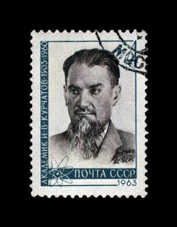 USSR - CIRCA 1963: cancelled stamp printed in the USSR, shows famous soviet scientist, physicist I. V. Kurchatov (1903-1960), circa 1963. vintage post stamp on black background. Editorial