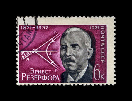 physicist: USSR - CIRCA 1971: cancelled stamp printed in the USSR, shows famous scientist, British physicist Ernest Rutherford (1871-1937) and diagram of movement of atomic particles, circa 1971. vintage post stamp on black background.