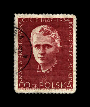 POLAND - CIRCA 1967: canceled stamp printed in Poland, shows famous polish Nobel prize winner in 1903, 1911 - physicist, scientist, radioactivity observer Marie Sklodowska-Curie, circa 1967. vintage post stamp isolated on black background. Editorial