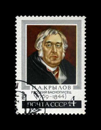 postmarked: USSR - CIRCA 1969: canceled stamp printed in USSR shows famous fable writer Ivan Krylov (1769-1844), circa 1969. vintage post stamp isolated on black background.
