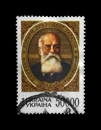 Mykhailo Hrushevsky (1866-1934) - first Ukrainian President (head) of the Central Rada (Ukrainian 1917-1918 revolutionary parliament), circa 1995. vintage canceled post stamp isolated on black background. Editorial