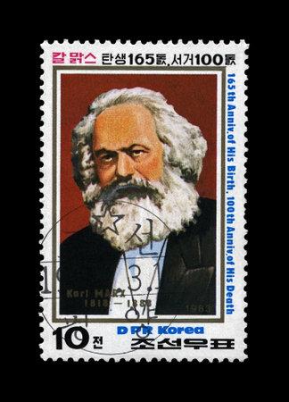 Karl Marx, famous politician leader, Capital - Critique of Political Economy book author, circa 1983., DPR KOREA (NORTH KOREA. canceled postal vintage stamp  isolated on black background.