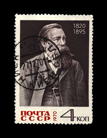 MOSCOW, USSR - CIRCA 1970: canceled postal stamp printed in the USSR shows Friedrich Engels (1820-1895), famous politician leader, circa 1970. Vintage stamp isolated on black background. Sajtókép