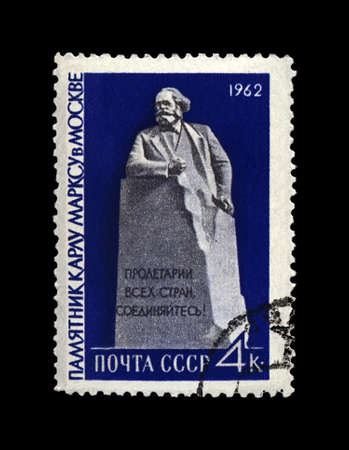 Karl Marx monument in Moscow, famous politician leader, Capital book author. canceled postal stamp printed in the USSR, circa 1962. Vintage stamp isolated on black background. Editorial