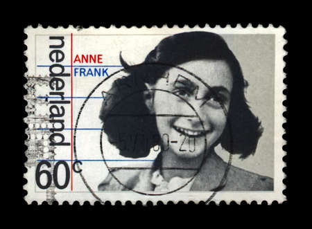 Jewish girl Anne Frank, 35th anniversary of liberation from the Germans, Netherlands, circa 1980.  canceled vintage postal stamp isolated on black background. Sajtókép