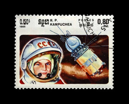 Valentina Tereshkova, 1st woman in the space,  soviet astronaut, rocket shuttle, circa 1985. canceled vintage post stamp printed in Cambodia (Republic of Kampuchea) isolated on black background.