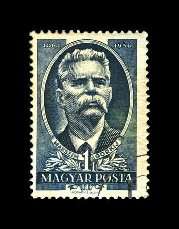 HUNGARY - CIRCA 1951: canceled stamp printed in the Hungary shows Maxim Gorky aka Alexei Maximovich Peshkov (1868-1936), famous Russian writer, dramatist, politician, 15th anniversary of the death of Gorki, circa 1951. vintage postal stamp isolated on bla