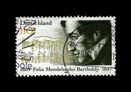 GERMANY - CIRCA 1997: canceled stamp printed in Germany shows Jakob Ludwig Felix Mendelssohn Bartholdy (1809-1847), famous German composer, pianist, author of Wedding March, circa 1997. Vintage stamp isolated on black background.