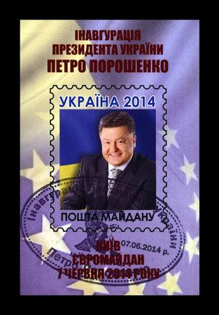 KIEV, UKRAINE - CIRCA 2014: canceled stamp printed in Ukraine shows Petro Poroshenko, President of Ukraine, inauguration on June 07, 2014, circa 2014. Vintage stamp isolated on black background.