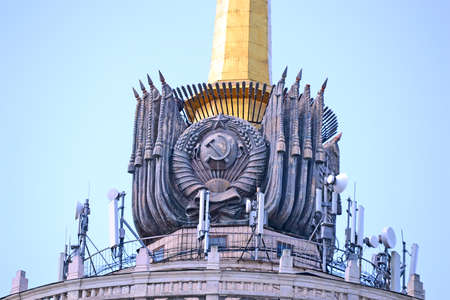 vintage USSR symbol and mobile radio antennas on June 08, 2018 in Kiev, Ukraine. USSR country not exist since 1991.