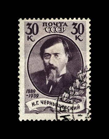 Nikolai Chernyshevsky (1828-1889), famous russian scientist, critic, revolutionary and writer. 50th anniversary of the death. vintage canceled postal stamp printed in the USSR, circa 1939. isolated on black background. Redakční