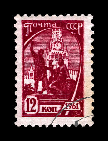 MOSCOW, USSR (RUSSIA) - CIRCA 1961: canceled postal stamp printed in USSR (Russia) shows Pozharsky (sitting) and Minin (standing) monument statue on Red Square, circa 1961. It was built during 1816-1818. vintage post stamp isolated on black background.