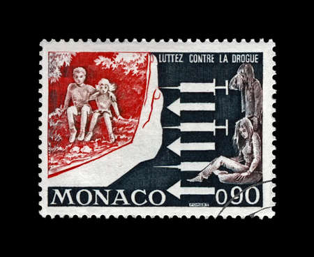 Campaign against drugs addiction among youth, fight against junkie issue, circa 1973. vintage canceled postal stamp printed in Monaco isolated on black background.