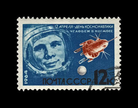Yuri Gagarin (1934-1968), first russian, soviet astronaut in the space, space-vehicle shuttle, circa 1964.  canceled vintage post stamp printed in the USSR (Soviet Union) isolated on black background. Редакционное