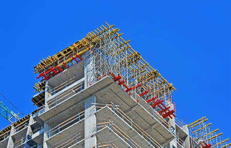 colorful scaffolding on azure sky in sunny day, modern building site diversity