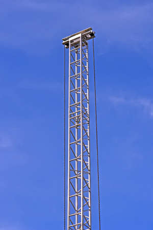 high metal construction pylon on blue sky in sunny day, environment diversity