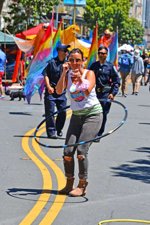 SAN FRANCISCO, USA - APR 30, 2017: unknown smiling female with hoop during Sunday Streets Tenderloin event on April 30, 2017 in San Francisco, USA. It is free neighborhood entertainment city Street car-free festival.