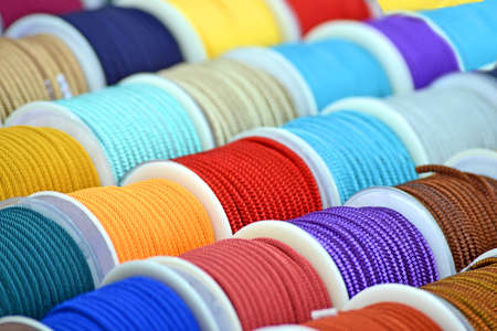 rainbow textile cord coils pack heap on the wall, modern industry strings diversity