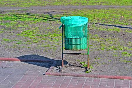 green trash bin closeup in sunny day, clear environment diversity