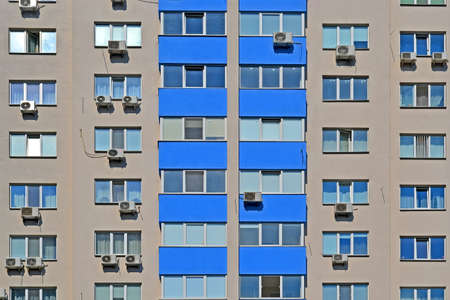 modern building wall with blue balcony line and glass windows, real estate diversity Banque d'images