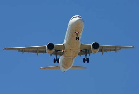 commercial aircraft preparing to land with gear down photo