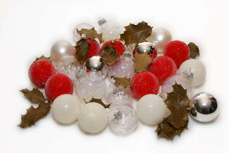 bunch of christmas decorating balls with holly leaves photo
