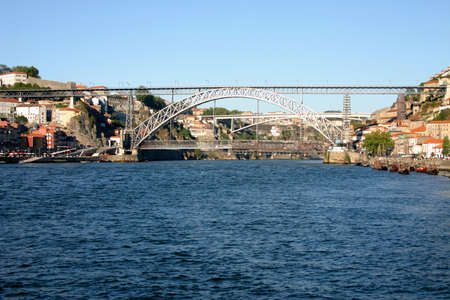 margins: view of Douro river with D. Luis bridge connecting both margins