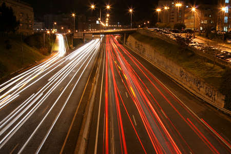 streaks: overview of a highway at night with multiple light streaks Stock Photo