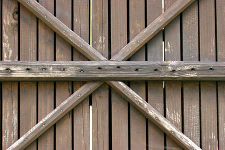 Wooden wall with a cross Stock Photo - 2536545