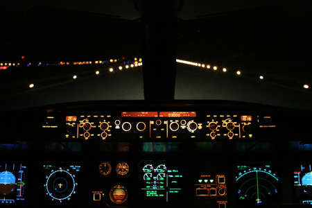 landed: aircraft landing at night with runway ahead