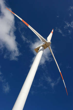 wind force: wind mill power generator in a deep blue sky Stock Photo