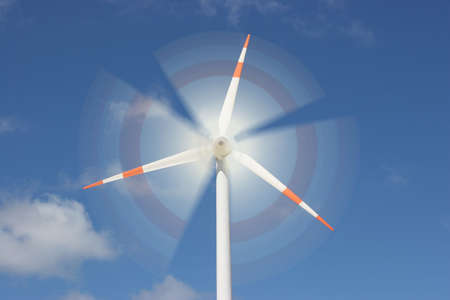 wind force: motion effect on wind mill power generator Stock Photo