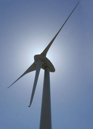 wind mill power generator backlit vertical perspective photo