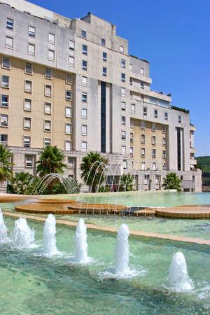 luxury condominium with water fountains photo