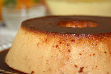 self indulgence: flan pudding viewed from the side Stock Photo