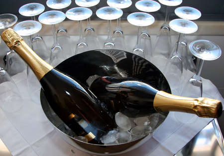 jubilation: champagne bottles on a bowl with glasses around