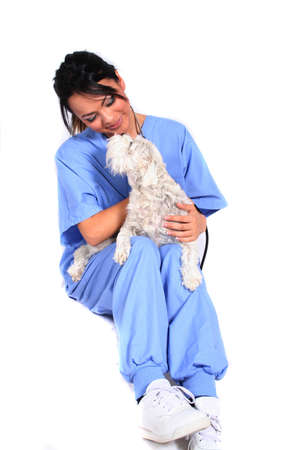 lpn: Female Healthcare Worker or Veterinarian with Dog