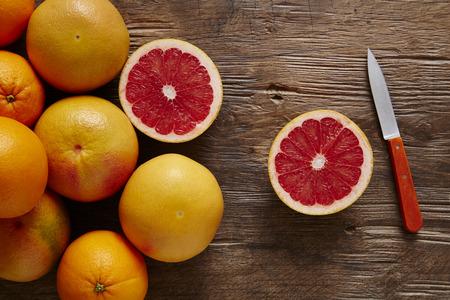 freshly sliced ??organic grapefruit with knife