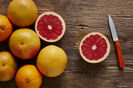 bunch of organic grapefruit sliced ??with orang knife