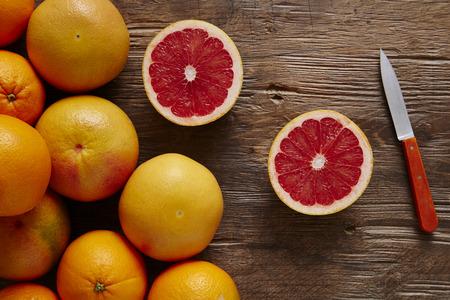 fresh organic grapefruit sliced ??orange with knife Stock Photo