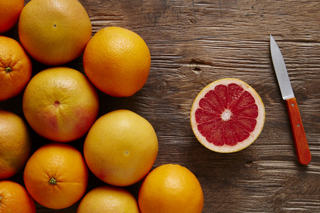 focal point: bunch of organic grapefruit and sliced ??� �