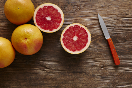 southsea: freshly sliced ??grapefruit with knife