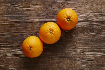 southsea: three organic oranges forming ascending line Stock Photo