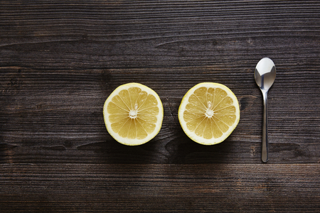 southsea: two slice citrus fruits with spoon Stock Photo