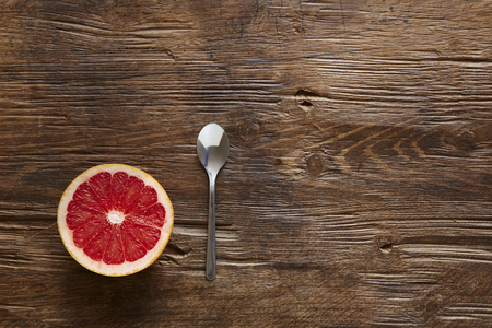 southsea: sliced ??organic grapefruit and spoon ready to eat