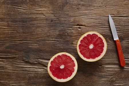 healthy organic grapefruit sliced ??orange with knife Stock Photo