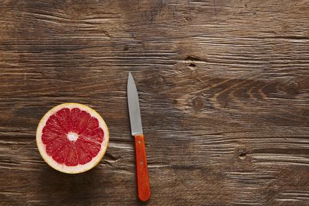 sliced ??organic grapefruit and orange knife