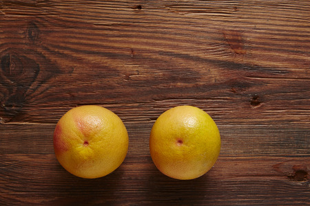 southsea: two organic grapefruits on wooden surface