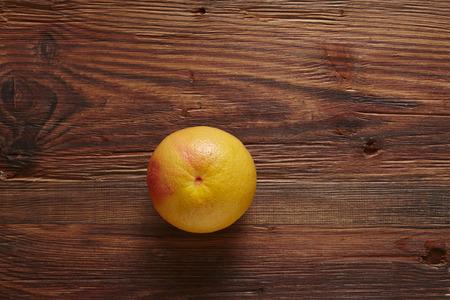 southsea: single organic grapefruit on wooden surfaces Stock Photo