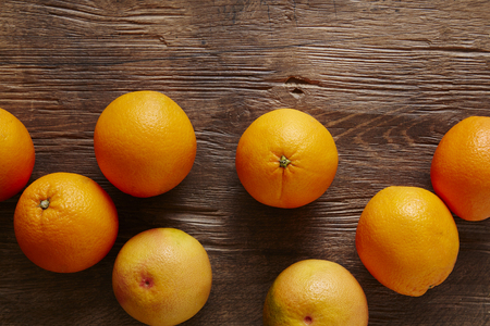 southsea: jumble of organic citrus fruits on wooden surface